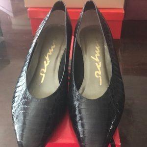 Navy blue heels with alligator skin design